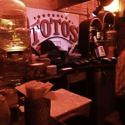 Totos Garage image for unsobered listicle on what your bar preference says about you
